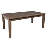 Ulker Extendable Pine Solid Wood Dining Table by August Grove®