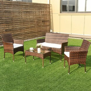 Sumrall 4 Piece Rattan Sofa Seating Group with Cushions
