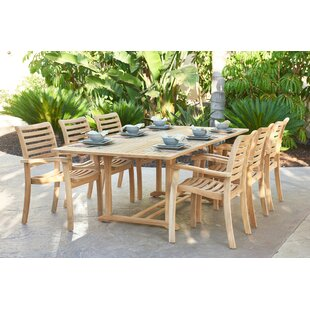 Parra Extendable Solid + Manufactured Wood Dining Table by Rosecliff Heights