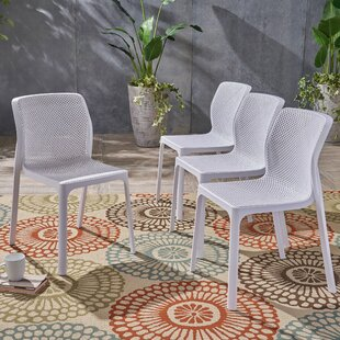 Ebern Designs Neve Outdoor Stacking Patio Dining Chair (Set of 4)