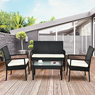 Caldwell Outdoor 4 Piece Rattan Sofa Seating Group with Cushions