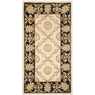 Olivia Hand-Tufted Wool Ivory/Brown Area Rug by Safavieh
