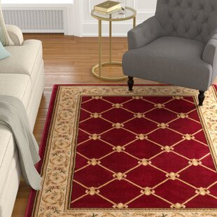 Affordable Colindale Fleur De Lis Red Area Rug By Astoria Grand