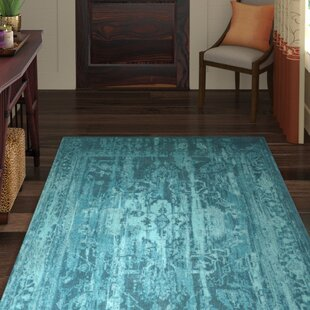 Mcintosh Hand-Woven Teal Area Rug by World Menagerie