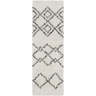 Compare Calvin Bohemian Hand Woven Wool White/Camel Area Rug By Foundry Select