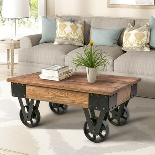 Comparison Deon Coffee Table by Williston Forge