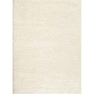Find the perfect Caressa White Area Rug By Zipcode Design