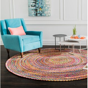 Coleman Hand-Braided Purple/Pink Area Rug by World Menagerie