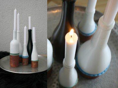 Kerzen auf die Flaschen stecken