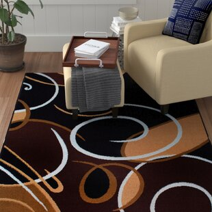 Find the perfect Simona Modern Swirls Black Area Rug By Winston Porter