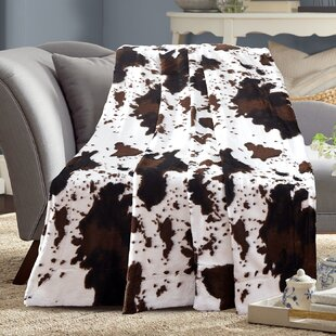 Marlborough Cow Print Reversible Faux Fur Blanket