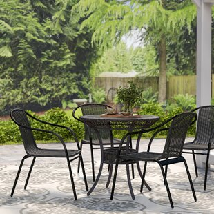 Abrahamic Stacking Patio Dining Chair (Set of 4) by Three Posts