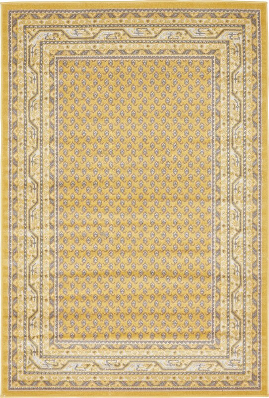 toni yellow area rug