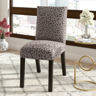 Bora Bora Upholstered Dining Chair in Gray by Ivy Bronx