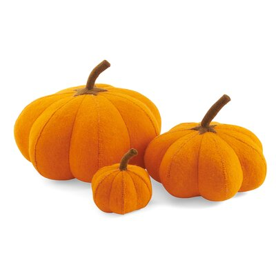 Three little pumpkins, sitting in a row. Use this pumpkin trio to adorn your Halloween or Thanksgiving table tops, or any area that needs a warm Harvest touch. Arcadia Home designs are handmade. Each design is as unique as the artisan who creates it.Arcadia Home felt designs are hand-felted, hand appliqued, and lovingly created from 100% sustainable wool by artisans working in India. The facility where these pieces are produced is an award-winning model of sustainability, which runs on solar electricity, collects rainwater, and recycles water on-site. By collaborating with this artisan group, Arcadia Home is helping to preserve the tradition of felt making in the area, promote eco-friendly business, and provide fair and safe employment for hundreds of artisan felt-makers, sheepherders, and seamstresses. Arcadia Home