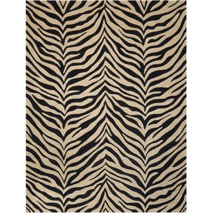 Find for Zambiana Hand-Tufted Black/White Area Rug By Michael Amini