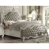 Tanner Solid Wood and Upholstered Standard Bed by Astoria Grand