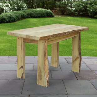 Raphael Solid Wood Dining Table by Loon P..
