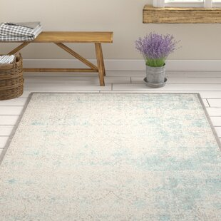 Auguste Turquoise/Ivory Area Rug By One Allium Way