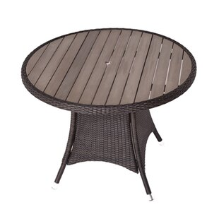 Arty Rattan Dining Table Image