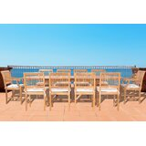 Dayne 11 Piece Teak Dining Set with Sunbrella Cushions