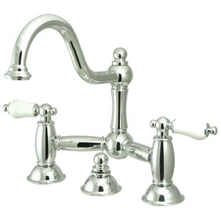 Kingston Brass Restoration Widespread Bathroom Sink Faucet with Brass Pop-up