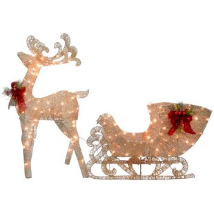 reindeer pulling sleigh lighted display