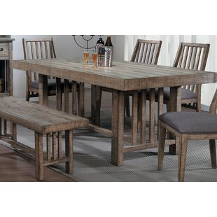 Union Rustic Huang Solid Wood Dining Table