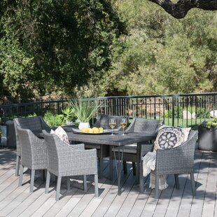 Orren Ellis Lueck Outdoor Wicker 7 Piece Dining Set with Cushions