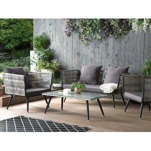 Tom Kuhl Patio 4 Piece Rattan Sofa Seating Group with Cushions