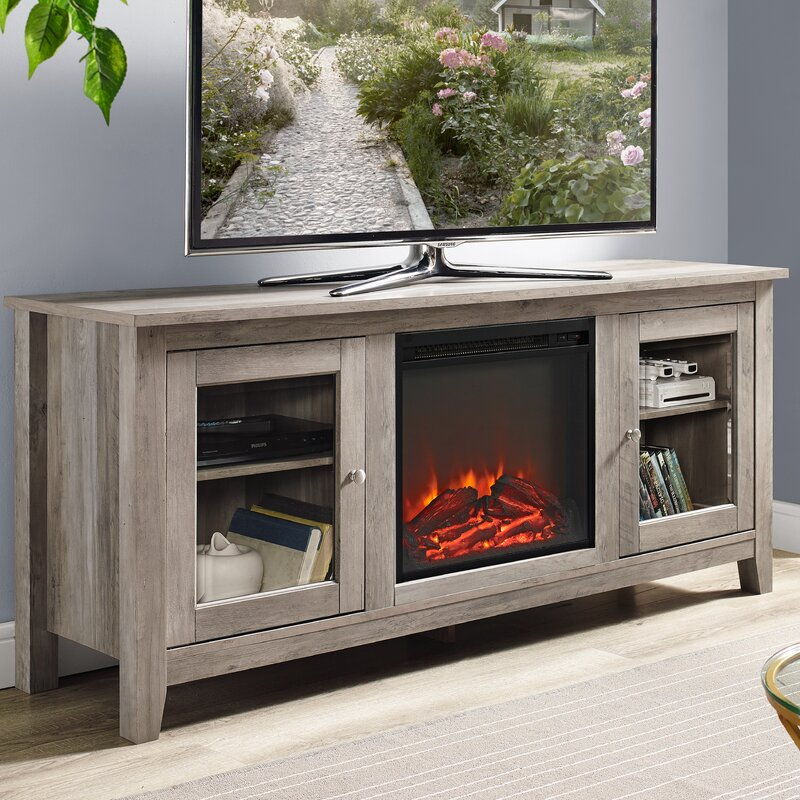 an electric fireplace accents this tv stand lending it visual appeal while clean lines pair with adjustable shelves for ample storage space