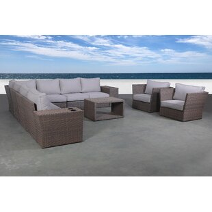 Cody 12 Piece Rattan Sectional Seating Group with Cushions