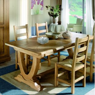 Kinzie Extendable Solid Wood Dining Table Loon Peak