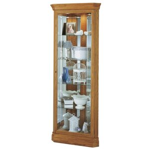 Hammond Lighted Corner Curio Cabinet by Howard Miller®