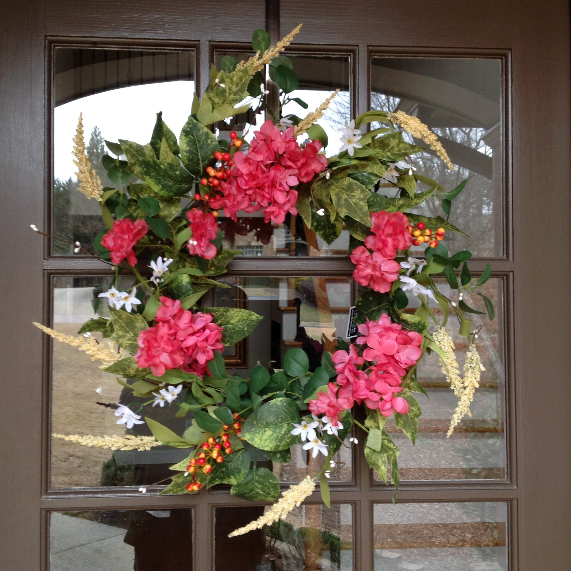 Green Hydrangea Wreath with green and pink accent flowers on a grapevine wreath