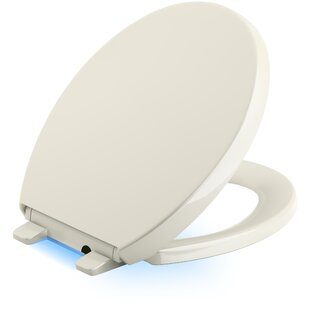 Kohler Reveal Nightlight Quiet-Close with Grip-Tight Round-Front Toilet Seat