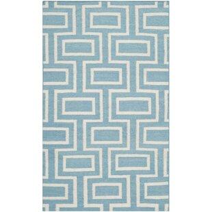 Dhurries Hand-Woven Wool Light Blue Area Rug bySafavieh