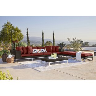 Ellie 7 Piece Rattan Sectional Seating Group with Cushions