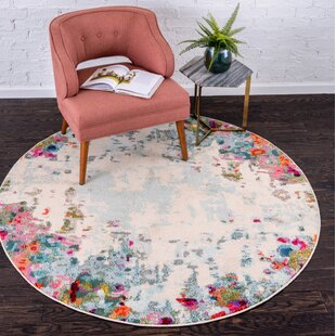 Annmarie Cream Area Rug by Turn on the Brights