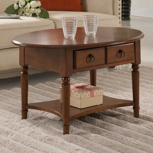 Husted Solid Wood Coffee Table with Storage by Charlton Home