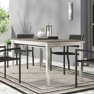 Coline Plastic/Resin Dining Table by Orren Ellis