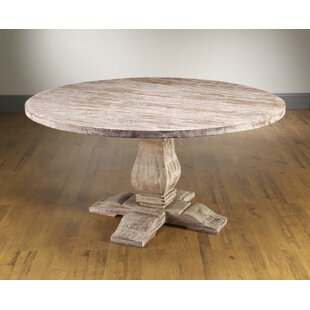 Jenifer Solid Wood Dining Table by Opheli..