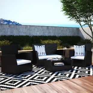 Dunlap 4 Piece Rattan Sofa Set with Cushions by Wade Logan