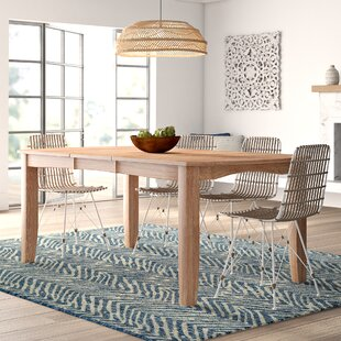 Lynn Extendable Solid Wood Dining Table Mistana