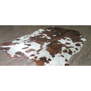Compare prices Lynnfield Hand Woven Cowhide Brown/White White Area Rug ByLoon Peak