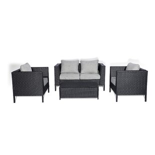 Whittiker 4 Piece Rattan Sofa Seating Group with Cushions