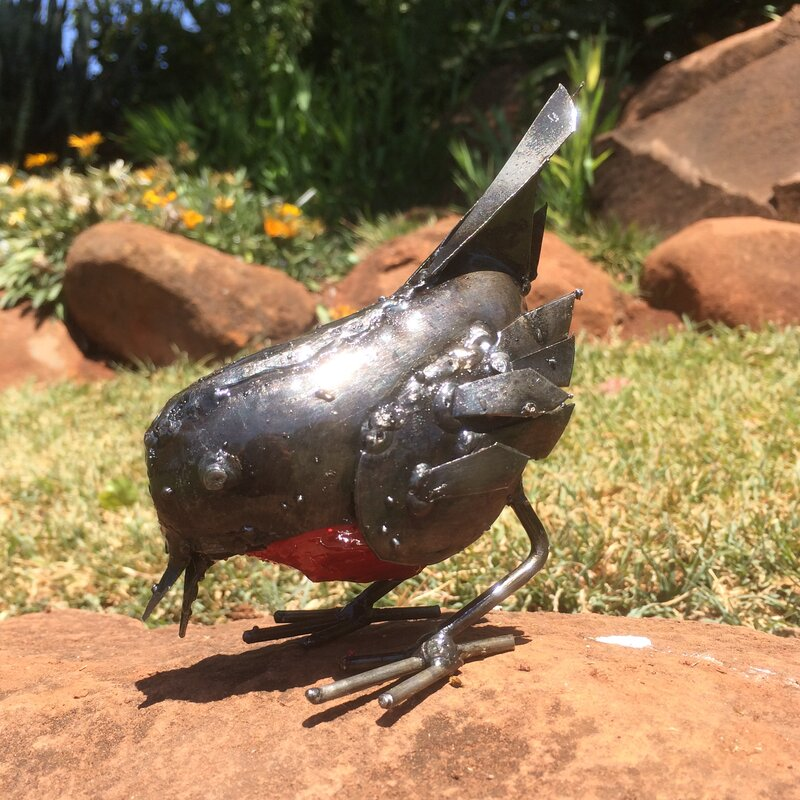 Rspb recycled metal robin pecking statue