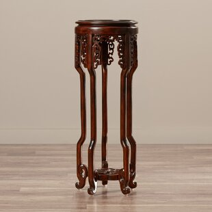 Find for Solid Wood Mahogany Pedestal Plant Stand By World Menagerie