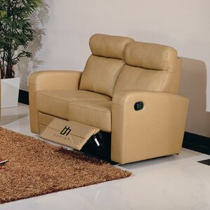 Leather Reclining Loveseat..