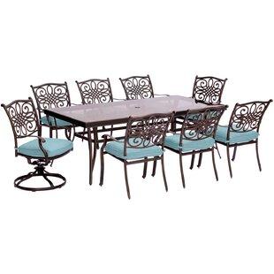 Three Posts Lauritsen 9 Piece Rectangular Glass Top Dining Set with Cushions